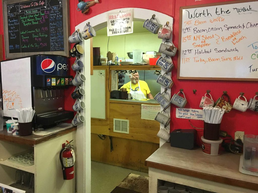 A look through a open doorway into the kitchen at Otis Cafe.