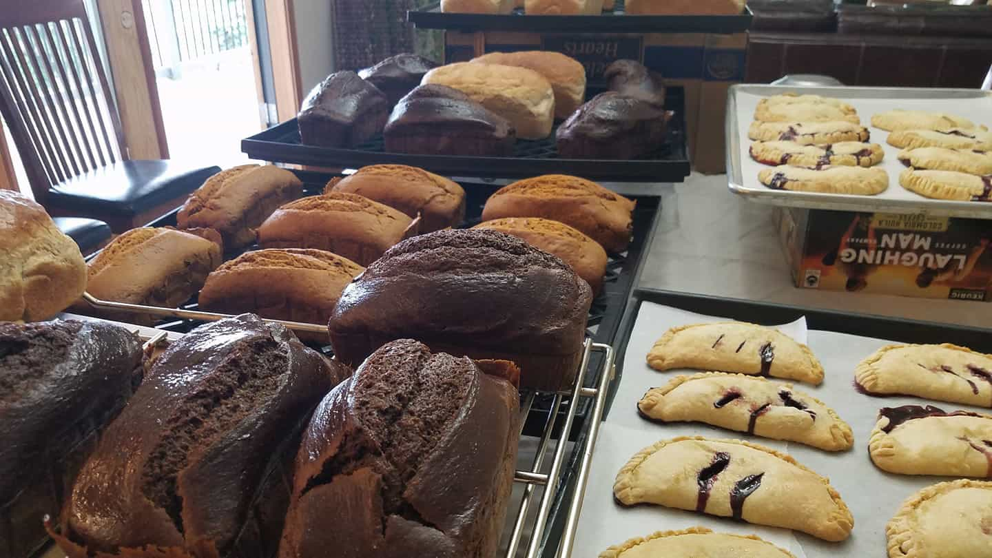 Trays of fresh pumpernickel bread and delicious turnovers